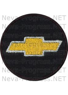 Шеврон в салон автомобиля ШЕВРОЛЕ (CHEVROLET) круг диаметр 60 мм. (черный фон, черный кант, метанить)