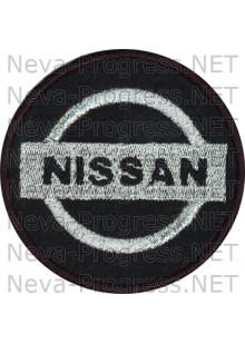 Шеврон в салон автомобиля НИССАН (NISSAN) круг диаметр 60 мм. (черный фон, черный кант, метанить)
