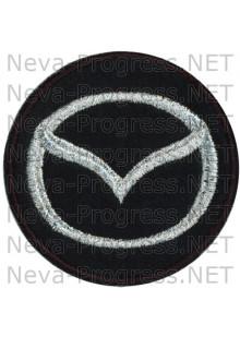 Шеврон в салон автомобиля МАЗДА (MAZDA) круг диаметр 60 мм. (черный фон, черный кант, метанить)