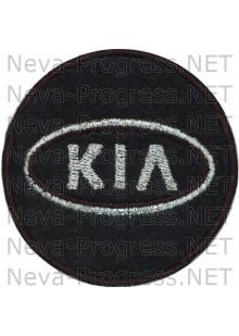 Шеврон в салон автомобиля КИА (KIA) круг диаметр 60 мм. (черный фон, черный кант, метанить)