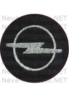 Шеврон в салон автомобиля  ОПЕЛЬ (OPEL) круг диаметр 60 мм. (черный фон, черный кант, метанить)