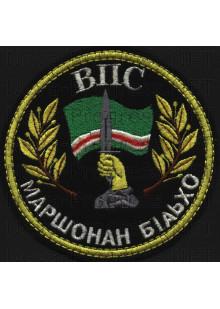 Шеврон Чеченская Республика до 1999 года. ВПС Маршонан бIаьхо. (Военно-патриотический союз - Защитники свободы)  Желтый кант. Черный фон