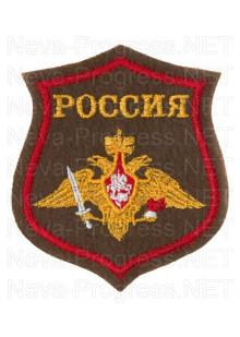 Шеврон Сухопутные войска РФ с надписью РОССИЯ по родам войск образца с 2012 года, желтая надпись и орел (оливковый фон, красный кант)