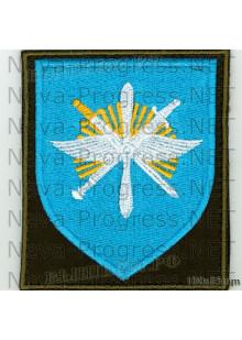 Шеврон 329-й Отдельной смешанной авиационной эскадрильи (329 ОСАЭ) в/ч 13641 «Снежная эскадрилья» аэродром Ключи Камчатская область (оливковый фон, голубой щит)