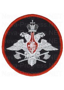 Шеврон Инжинерные войска ВС РФ (Приказ МО РФ № 315 от 18 июня 2000 г.)  Белый орел с топорами, черный фон, красный кант, оверлок